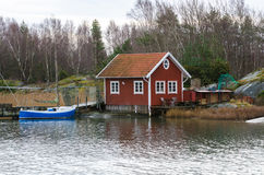 Fishermans boathouse and boat with pier Stock Photos