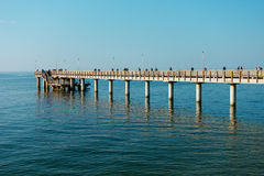 Fishermans catching fish from the pier Royalty Free Stock Images