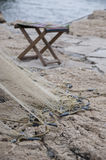 Fishermans chair and net Royalty Free Stock Photo