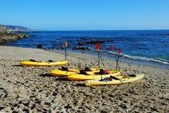 Fishermans Cove with kayaks, Laguna Beach, CA. Image show kayaks on the beach of Fishermans Cove in North Laguna Beach, California royalty free stock images