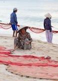 Fishermans dragging fishing nets Stock Photo
