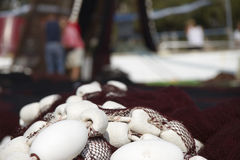 Fishermans and fishing net Stock Images