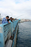 Fishermans at Galata Bridge Stock Photos