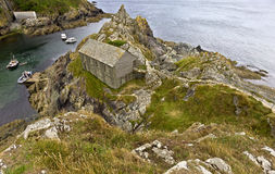 Fishermans hut on cliffs in Polperro harbour in Cornwall, United Kingdom Stock Image