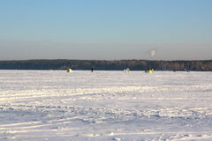 Fishermans on ice for fishing Stock Images