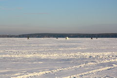 Fishermans on ice for fishing Royalty Free Stock Photography
