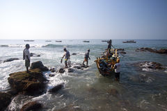 Fishermans.(Lamalera,Indonesia). Fishermen from the fishing village Lamalera unload the fish caught.The village of Lamalera on the Indonesian island of Lembata stock photos