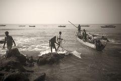 Fishermans.(Lamalera,Indonesia). Fishermen from the fishing village Lamalera unload the fish caught.The village of Lamalera on the Indonesian island of Lembata stock images