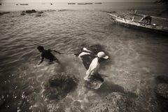 Fishermans.(Lamalera,Indonesia). Fishermen from the fishing village Lamalera unload the fish caught.The village of Lamalera on the Indonesian island of Lembata stock photography