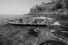 Fishermans.(Lamalera,Indonesia). Fishermen from the fishing village Lamalera unload the fish caught.The village of Lamalera on the Indonesian island of Lembata royalty free stock photography