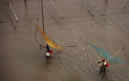 Fishermans met netten Stock Afbeelding