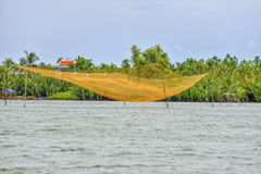 Fishermans net at the Thu Bòn River in Hoi An, Vietnam Stock Photo