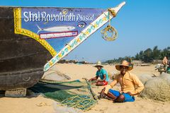 Fishermans picking up their nets Royalty Free Stock Images