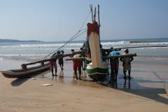Fishermans roll back their boat in Sri Lanka stock image