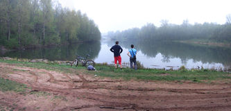 Fishermans standing on the pond Royalty Free Stock Images