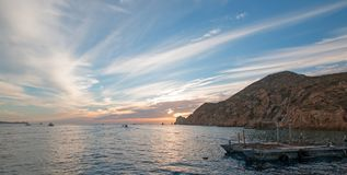Fishermans sunrise view of bait supply boat at Lands End in Cabo San Lucas in Baja California Mexico Stock Photo