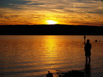 Fishermans in sunset Royalty Free Stock Photos