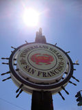 Fishermans Wharf San Francisco sign, sun over Royalty Free Stock Image