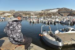 Fishermans working on arctic ocean in Ilulissat marine, Greenland. May 2016 Royalty Free Stock Photos