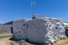 Fishermen's hut with antenna and solar panels. Royalty Free Stock Photo