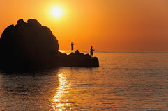 Fishermen. On sunrise fish in the sea stock image