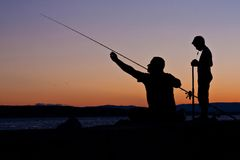The fishermen. At sunset - father and son Stock Photography