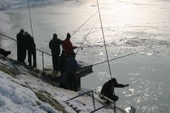 Fishermen. Fishing from the shore in ice Stock Images