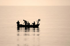 Fishermen. Three fishermen on board their small fishing boat in the Black Sea Stock Photos