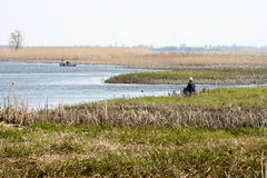 Fishermen. In boats in Biebrza National Park, Poland Royalty Free Stock Photography