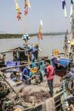 Fishermen aboard Stock Image