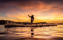 Fishermen in action when fishing in the lake royalty free stock photography