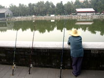 Fishermen along a canal around Forbidden City Royalty Free Stock Photo