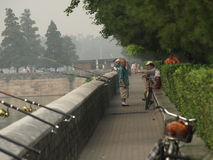 Fishermen along a canal around Forbidden City Royalty Free Stock Photos
