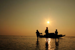 Fishermen of Andamans. Silhouette of fishermen working at the Andaman sea, India royalty free stock photo