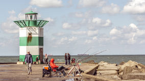 Fishermen angling on a pier in Scheveningen in Holland Royalty Free Stock Photos