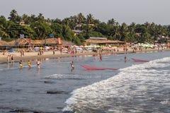 Fishermen on the Arambol beach. Arambol, Goa, India - February, 17th, 2017 Royalty Free Stock Image