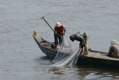 Fishermen At The Mekong River Stock Photo