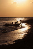 Fishermen back in the dawn at Amed beach Royalty Free Stock Images