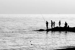 Fishermen in backlight Stock Images