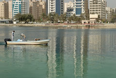 Fishermen in Bahrain. Although Bahrain is undergoing tremendous developments, there are still people who catch fish for a living Royalty Free Stock Image