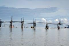 Fishermen in Bako. Fishermen setting up nets across the river in Bako, Sarawak, Malaysia Royalty Free Stock Image