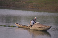 Fishermen in bamboo boats on the lake stock photo