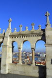 Fishermen Bastion arches Budapest view. Picturesque Hungary Parlament building,cityscape and Danube banks through Fishermen Bastion on blue skies background. It Stock Photography