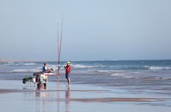Fishermen on the beach Stock Photos