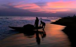 Fishermen on The Beach royalty free stock photos