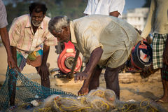Fishermen on the beach Marina Beach Royalty Free Stock Photos