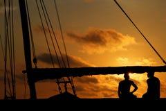 Fishermen on board at sunset Royalty Free Stock Photo