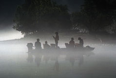 Fishermen in a boat Stock Photography