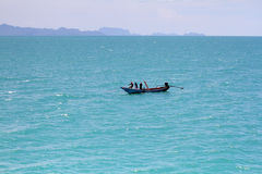 Fishermen in a boat. Catching fish in the sea Stock Photography