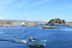 Fishermen in a boat in the archipelago of Gothenburg, Sweden, Scandinavia. Two fishermen in the archipelago of Gothenburg, Sweden, Scandinavia. An area from Stock Photos